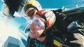 Parachutists Jumping in Tandem out of an Airplane Stok Video