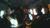 Group of skydivers sits inside a small plane awaiting a jump. Slow Motion Stok Video