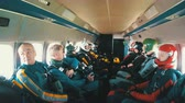 adrenaline : Group of skydivers sits inside a small plane awaiting a jump. Slow Motion Stock Footage
