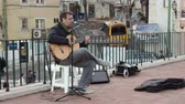 LISBON, PORTUGAL - MARCH 24, 2013: Street musician sing and playing music on an acoustic guitar in Lisbon