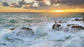 Wave splashing on the sea at sunset. nature composition. Force of storm power.