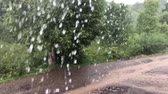 Water flows from the eaves slow motion. Heavy rain in the summer. Camera movement.