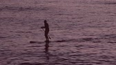 people on board into the sea sup Stock Footage