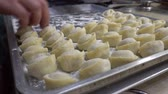 nourishment : Dumplings lie on the baking tray in rows. Stock Footage