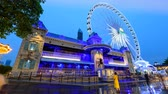 szórakoztatás : Bangkok, Thailand -  3 July, 2019 : Day to night time lapse The haunted house at amusement park in night time of ASIATIQUE The Riverfront shopping mall Stock mozgókép