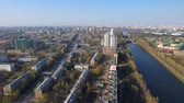 commute : Flying over Moscow on the drone. bird houses eye buildings. Sunny city.