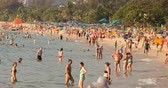 Phuket, Thailand- Febuary 21, 2018: People bathe in the sea and sunbathe on Karon beach.