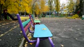 furniture : Bench in The Park in Autumn. Moving Camera Stock Footage