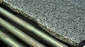 sertlik : Granite processing in manufacturing. Polishing granite plate on the machine