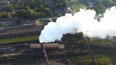 millsime : Flying over the smoking chimney. ironworks. Aerial survey