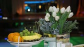 citrus fruit dish : Festive table decorated with fruits and flowers