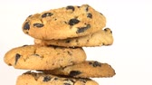 aveia : Biscuit Cookies with chocolate raisins rotates on a white table Vídeos