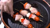 speck : Put chicken skewers in the pan. Slow motion Videos
