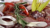 sprinkled : Dish with meat sprinkled with rosemary. slow motion