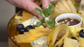 fruit vegetable : Cheese dish decorated with mint. slow motion Stock Footage