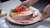 salmon pink : Dish with salmon put on the table. Slow motion