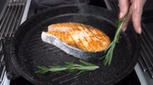 базилик : Salmon steak sprinkled with rosemary. Slow motion Стоковые видеозаписи