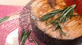 salmon pink : Salmon steak sprinkled with rosemary. Slow motion Stock Footage