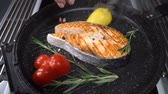 sweet peppers : Salmon steak sprinkled with salt and spices. Slow motion Stock Footage