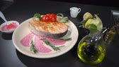 flor de la vida : Dish fried red fish steak in a restaurant Archivo de Video