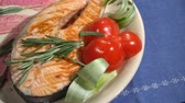 salmon pink : Dish fried red fish steak in a restaurant Stock Footage