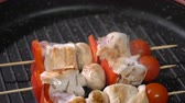 cooking : Chicken skewers fried in a pan Stock Footage