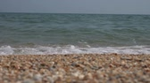 入り江 : Sea wave on the sandy shore of the Black Sea. Slow motion