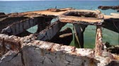 takviye edilmiş : Old rusty reinforced concrete structure on the Black Sea. Slow motion