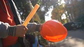 britse vlag : Workers baton with protective orange helmet for protests. Slow motion. Video with sound