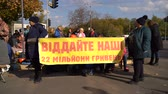 протест : Dnipro, Ukraine - 11 October 2019: The strike of metal workers near the bank. Slow motion