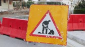 pave : Roadworks yellow sign with red and white barriers. Road under construction. Street blocked for reconstruction. Road detour. Stock Footage