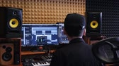 sztereó : Home music studio. Sound engineer mixing and mastering at sound music studio. Digital audio workstation. Home recording studio. Stock mozgókép