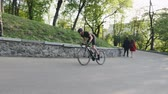 주기 : Skinny strong cyclist sprinting up the hill in the park. Cycling training in mountains. Cycling concept. Slow motion 무비클립