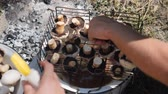 soğan : Human cooking grilled vegetables. Chef preparing mushrooms on barbecue. Women spread vegetables on grill outdoor