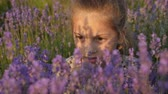aromaterapie : close up face lovely little girl, field lavender Dostupné videozáznamy