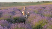 feelings emotions, little girl smile happiness merrily flees jumping outdoors. amazing lavender field. village provence Stok Video