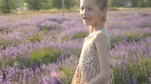 attractive little girl holiday in Provence. laughter and smiles feeling good, summer nature of Europe Stok Video