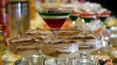 zastawa stołowa : dessert jelly and souffle in glass. wedding celebratory dinner. food design slide movement