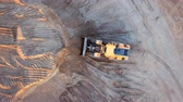 Aerial view loading bulldozer in open air quarry Vídeos