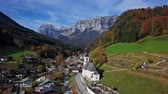 Flight over famous Parish church St. Sebastian, in Ramsau, Berchtesgaden, Bavarian Alps, Germany