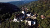 Flying over fortified church in picturesque historic village Spania Dolina, Slovakia