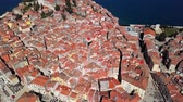 estreito : Top aerial view of roofs in old town Rovinj, Istria, Croatia. Stock Footage