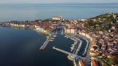 Aerial panorama of marina and old town Piran, with reflection at the sea, Slovenia