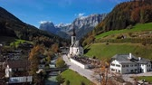 Flight near famous Parish church St. Sebastian, in Ramsau, Berchtesgaden, Bavarian Alps Germany.