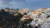 Day to night hyper lapse of Fira (Thira) town, Santorini island, Greece