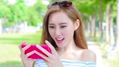university : woman play phone and mobile game in the park Stock Footage