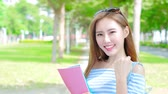 university : beauty woman student smile happily in the school Stock Footage