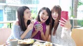 technology : woman friends smile and selfie in restaurant