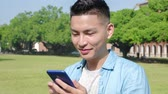campus : Happy man student use smart phone in the school