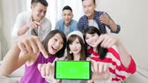 technology : young people show screen to you and smile happily, focus on the phone